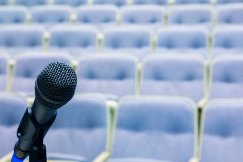 Microphone in front of seats in a conference room