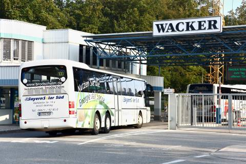Bus entering the factory gate in Burghausen