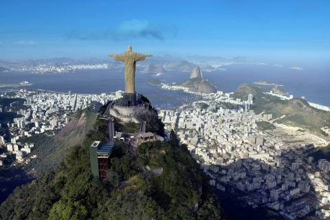 """Christ the Redeemer"" statue, with Rio de Janeiro in the background."