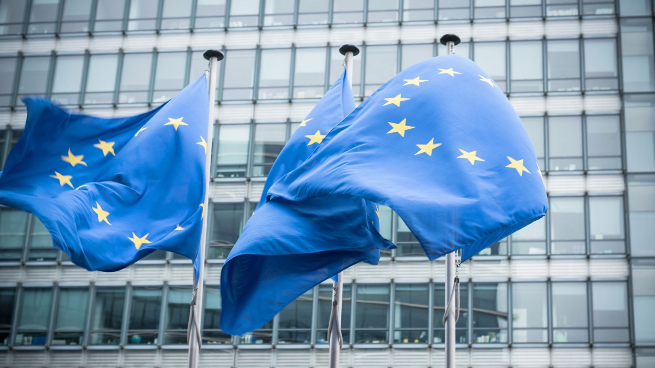 European flag in front of glass facade