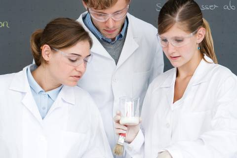 Young people in lab coats