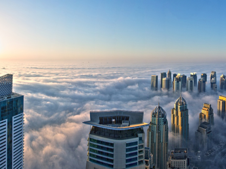 skyscrapers above clouds